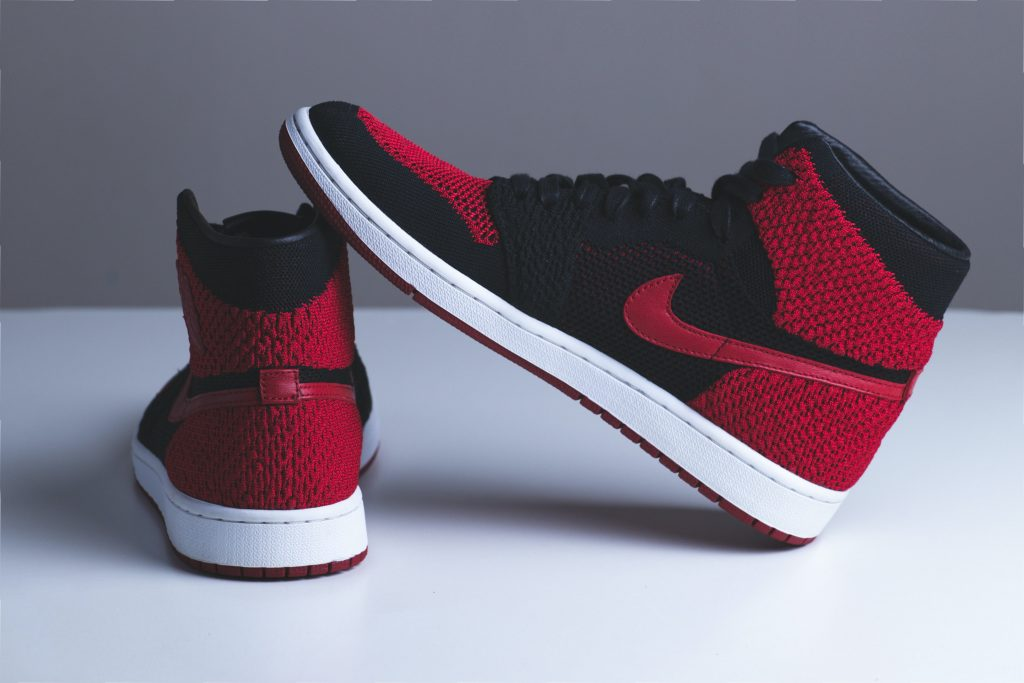 pair of red and black Nike sneakers